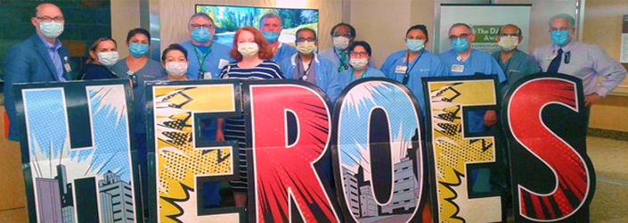 Sequoia staff members behind heroes sign