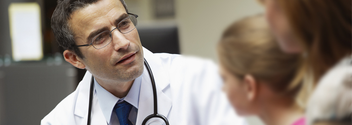 Photo of doctor talking with patients.